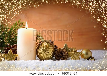 Christmas background with white advent candle and luminous lights.