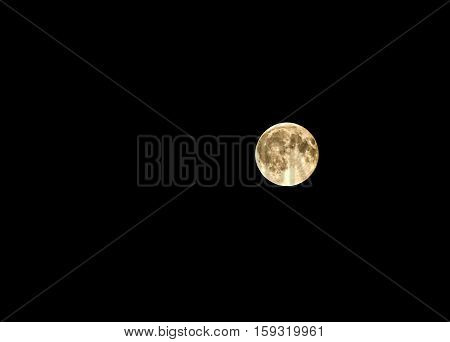 View of a full moon in the night sky.
