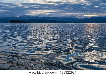 Landscape with silver water on a cloudy day