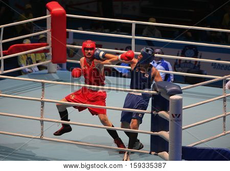 St. Petersburg Russia November 21 2016 AIBA Youth World Boxing Championships men heavy 91 kg. Boxing match between: RED- Filip C. Romania BLUE -Lee Y. South Korea