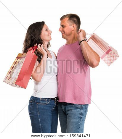 Happy couple with shopping bags on a white background. Enjoying purchases