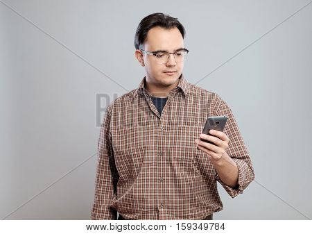 Young Adult Man Using Mobile Phone