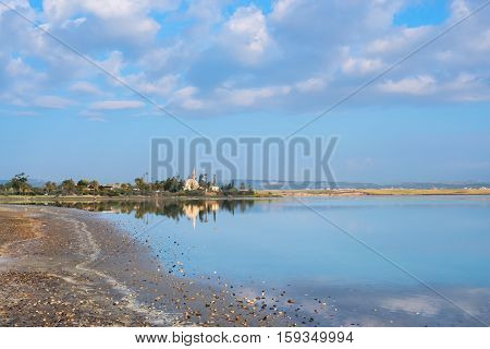 Mosque On The Background Of Colorful Clouds And Lake