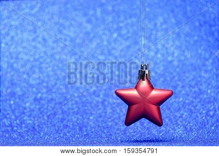 Small Red Christmas Star On Glitter Background