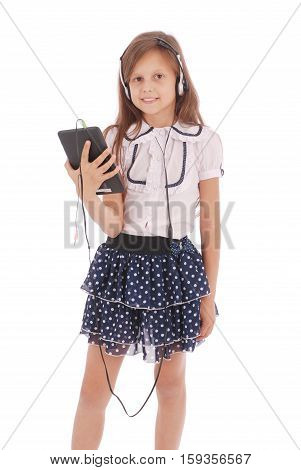 Beautiful cute happy young girl with headphones and tablet pc isolated on white