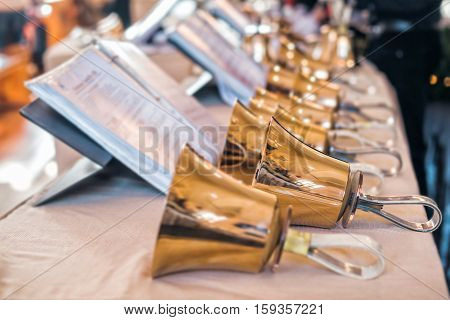 Handbells with sheet of music ready for performance