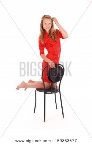 Beautiful young girl in black hat on his head isolated on white