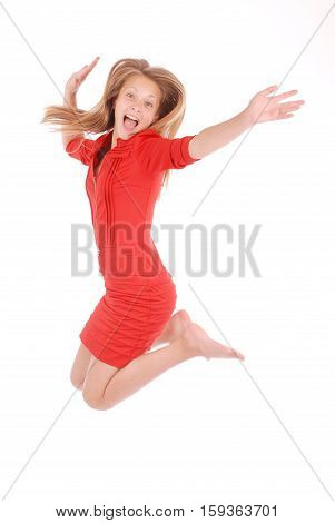 Cheerful young girl jumping on a white background