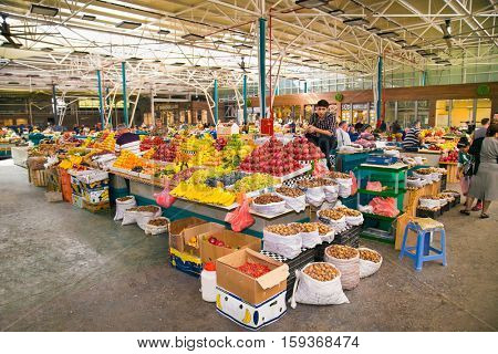 BAKU, AZERBAIJAN - OCT 4, 2016:  People and fruits seller at the green market in Baku on Oct 4, 2016. Azerbaijan