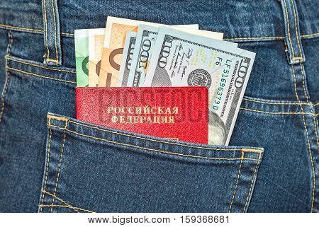 Russian passport euro and dollar bills in the back jeans pocket. Money for travel and shopping