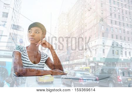 Portrait of a serious thoughtful african businesswoman using laptop in office