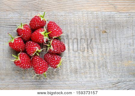 Ripe raspberry on wooden table top view