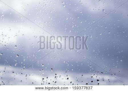 Rain drops on window on a cloudy day