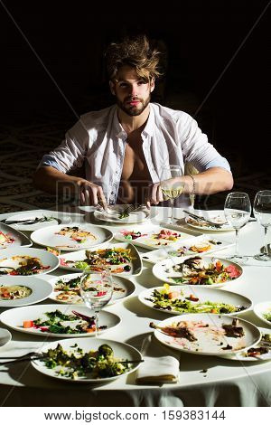 Handsome Man Eats At Table