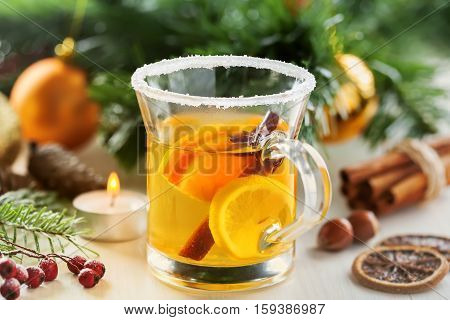 Christmas traditional hot drink. Mulled cider with fruits and cinnamon.