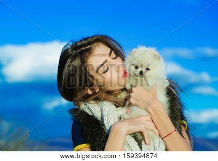 Pretty Girl Holds Cute Dog