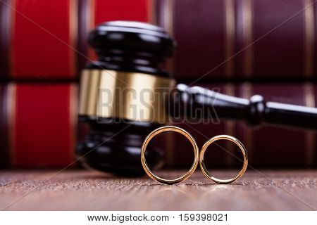 Close-up Of Wedding Rings Are Placed On Gavel In Courtroom