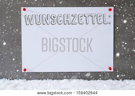 Label With German Text Wunschzettel Means Wish List. Urban And Modern Cement Wall As Background On Snow With Snowflakes.