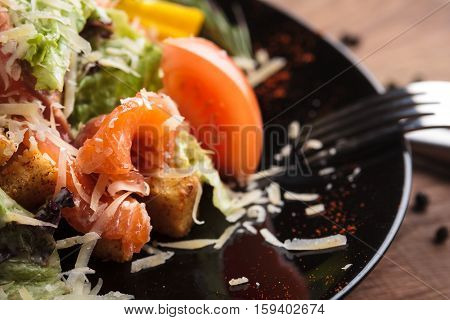Caesar Salad With Salmon And Cherry Tomatoes