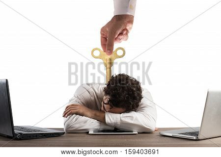 Businessman exhausted from overwork sleeping over a tablet