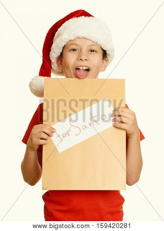 boy in red hat with letter to santa - winter holiday christmas concept, yellow toned