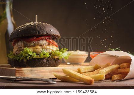 Trendy Burger With Chicken In Black Bun