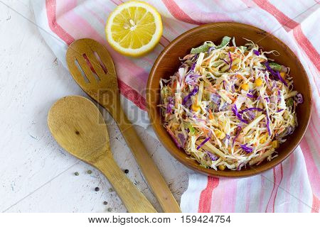 Salad coleslaw in a wooden bowl rustic style Top view with copy space
