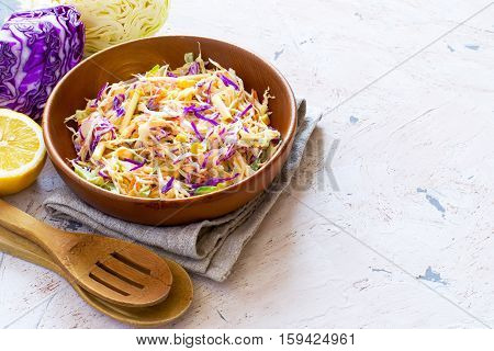 Salad coleslaw in a wooden bowl rustic style copy space.