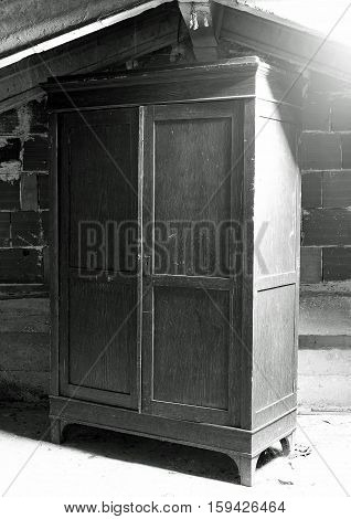 Wooden Cabinet In A Dusty Attic Of The House