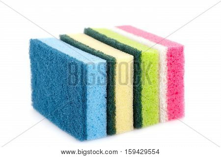 Four colorful sponges isolated on white background.