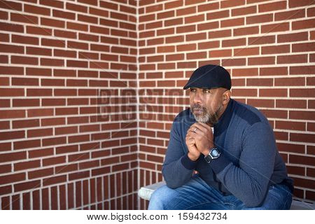 African American man sitting and thinking about life.