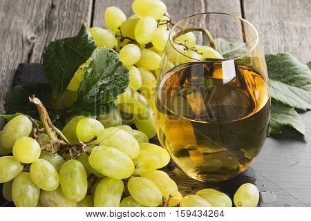 White Wine And Grapes On A Dark Background