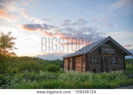 old log farmhouse in the beautiful sky