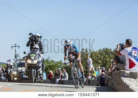 Col du Serre de TourreFrance - July 152016: The French cyclist Romain Bardet of AG2R La Mondiale Team riding during an individual time trial stage in Ardeche Gorges on Col du Serre de Tourre during Tour de France 2016.