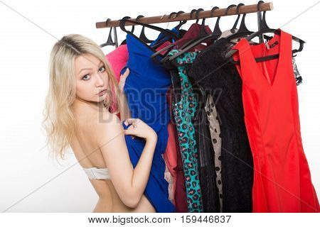 girl in underwear from clothes hangers. Isolated on white background. choice of dress