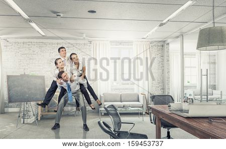 Businesspeople having fun in office . Mixed media