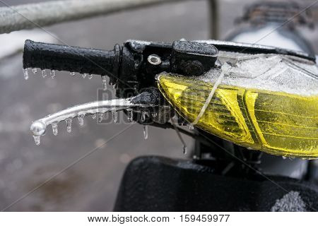 Handle Of Motorcycle Covered With Ice After Freezing Rain