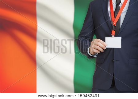 Businessman Holding Name Card Badge On A Lanyard With A National Flag On Background - Ivory Coast