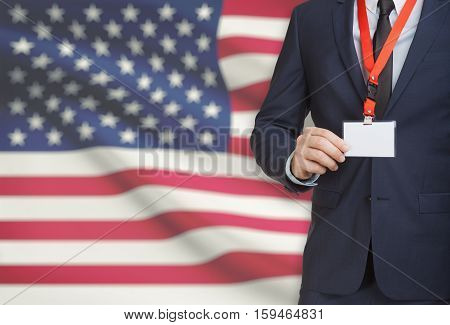 Businessman Holding Name Card Badge On A Lanyard With A National Flag On Background - United States