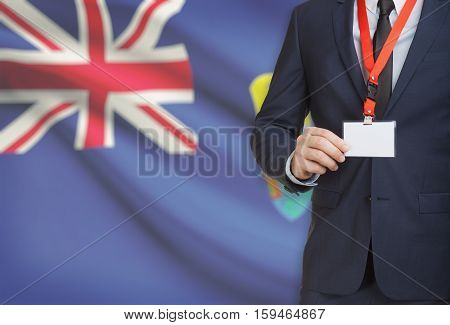 Businessman Holding Name Card Badge On A Lanyard With A National Flag On Background - Saint Helena