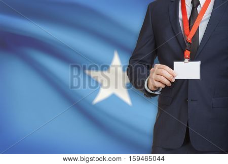 Businessman Holding Name Card Badge On A Lanyard With A National Flag On Background - Somalia