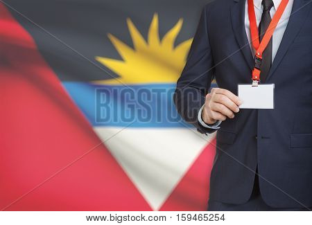 Businessman Holding Name Card Badge On A Lanyard With A National Flag On Background - Antigua And Ba