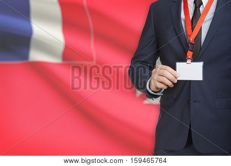 Businessman Holding Name Card Badge On A Lanyard With A National Flag On Background - Wallis And Fut