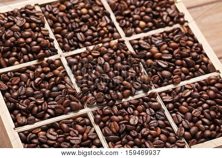 Roasted coffee beans in the wooden basket