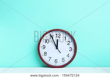 Red Round Clock On A Mint Background