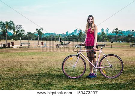Girl With Her Bike At Villa-lobos Park In San Paulo (sao Paulo), Brazil (brasil)