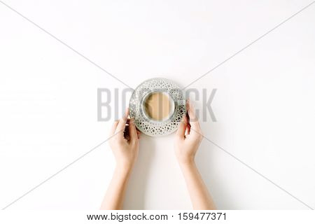 girl's hands holding coffee cup. flat lay top view