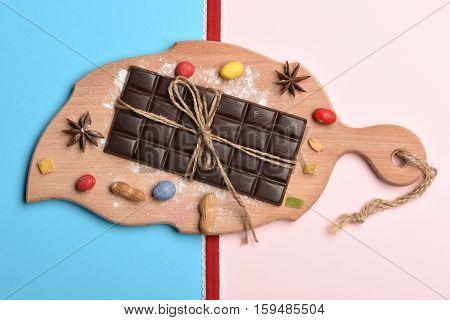 Dark Chocolate Bar On Cutting Board