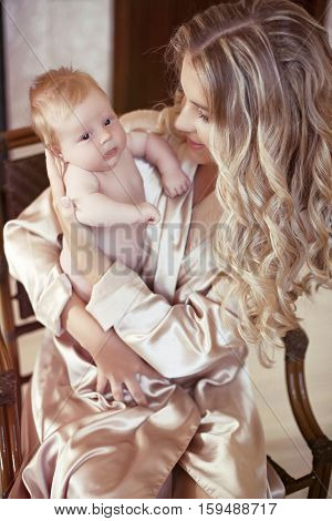 Adorable Baby. Happy Beautiful Mother Holding Her Newborn. Mom Playing With New Born Girl Child. Fam