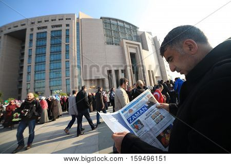 ISTANBUL,TURKEY-DEC 14:Turkish police raid Zaman building, attempt to detain editor. A crowd of protesters forced police to turn back before they could make arrests on Dec 14, 2014 in Istanbul,Turkey.